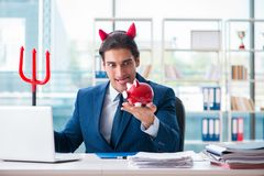 The devil angry businessman in the office. Devil angry businessman in the office Royalty Free Stock Photo
