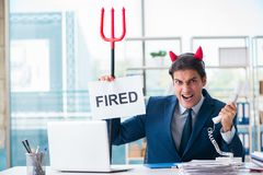 The devil angry businessman in the office Stock Images