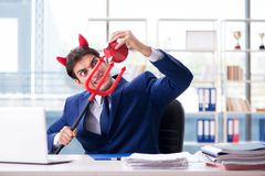 The devil angry businessman in the office. Devil angry businessman in the office Stock Images