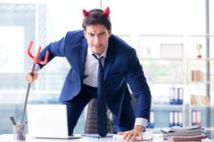 The devil angry businessman in the office. Devil angry businessman in the office Stock Photography
