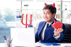 The devil angry businessman in the office. Devil angry businessman in the office Royalty Free Stock Photography