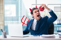The devil angry businessman in the office. Devil angry businessman in the office Stock Image