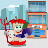 Devil apple core holding laptop in front of an office building Royalty Free Stock Image