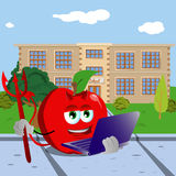 Devil apple holding laptop in front of a school Stock Images