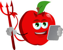 Devil apple using a tablet Stock Images