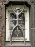 The devil as a window grate Royalty Free Stock Photography