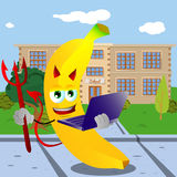 Devil banana holding laptop in front of a school Royalty Free Stock Image