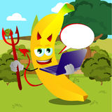 Devil banana holding laptop on a meadow Stock Photography