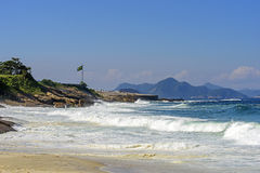 Devil beach. View of Diabo beach, Copacabana Fort in the hills of Niteroi in the background Stock Photo