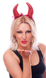 Devil blonde sending kiss Royalty Free Stock Photography