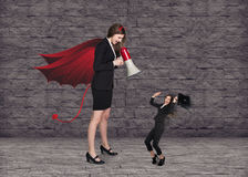 Devil businesslady with a megaphone screeming Stock Image