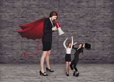 Devil businesslady with a megaphone screeming Stock Photos