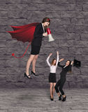 Devil businesslady with a megaphone screeming Royalty Free Stock Images