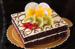 Devil Cake. Collocation of fruit and chocolate Royalty Free Stock Photos