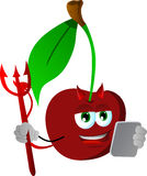Devil cherry using a tablet Royalty Free Stock Photos
