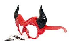 Devil disguise masquerade glasses. Isolated on a white background royalty free stock image