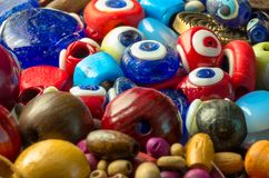 Devil eyes and colorful beads. Macro photograph of some well detailed devil eyes and colorful beads Stock Images