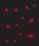 Devil eyes in the dark Royalty Free Stock Images