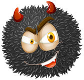 Devil face on fluffy ball Royalty Free Stock Photos