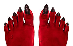 Devil Feet. And red zombie feet as a creepy Halloween or scary symbol with textured wart infested wrinkled skin monster foot toes isolated on a white background Royalty Free Stock Photo