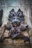 Devil figure, bronze sculpture with demonic gargoyles and monste. Rs Royalty Free Stock Photos