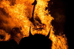Devil in front of fire Stock Photo