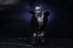 Devil girl in a chains Royalty Free Stock Image