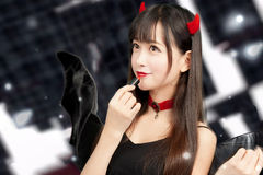 Devil girl cosplay Halloween woman sexy glamour Royalty Free Stock Photo