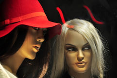 Devil girl, evil woman. Devil girl, attractive mannequin with jealousy eyes and demonic horns, concept of evil royalty free stock image