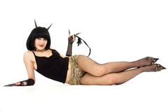 Devil girl lies on a white background stock image