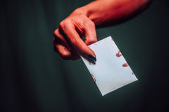 Devil hand gives empty card Royalty Free Stock Images