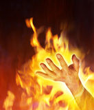 Devil Hand In Hell Satan. Satan's hand reaching out of fire and flames Royalty Free Stock Images