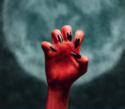 Devil hand at midnight Royalty Free Stock Image
