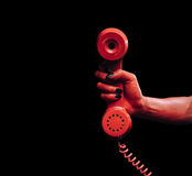 Devil hand with phone handset Stock Photos