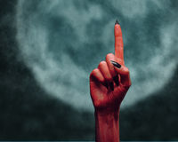 Devil hand pointing upward Stock Photo