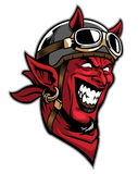 Devil head rider wearing an old helmet Stock Photography