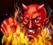 Devil in Hell Fire. A devil surrounded by flames and fire pointing at the viewer Stock Image