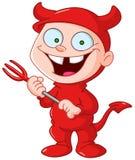 Devil kid. Smiling kid in a devil costume celebrating Halloween Stock Photo