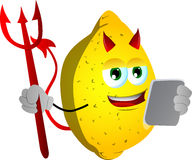 Devil lemon using a tablet Royalty Free Stock Images