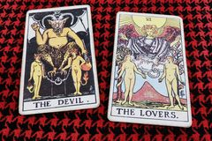 The DEVIL & The LOVERS. Tarot cards. Gypsy Tarot Horoscope argur seer Relationship Predict Stock Photography