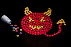 Devil made from pills with pill bottle Stock Photo
