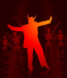 Devil man dancing with skeletons in the background Royalty Free Stock Photo