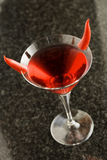 Devil Martini. Red martini cocktail with pepper decoration Royalty Free Stock Photo