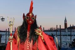Devil masked man Stock Photography