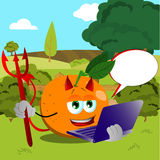 Devil orange holding laptop on a meadow Stock Images
