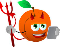 Devil peach using a tablet Stock Image