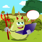 Devil pear holding laptop on a meadow Stock Photos