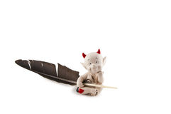 Devil with the pen. Isolated on a background Stock Images