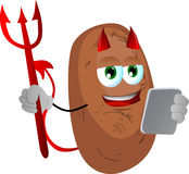 Devil potato using a tablet Royalty Free Stock Images