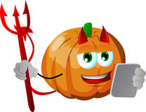 Devil pumpkin using a tablet Royalty Free Stock Image